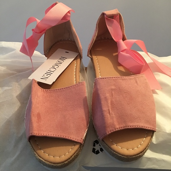 35ade9580 Brand New Pink suede looking ribbon ankle sandals.